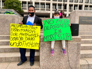 Little girl holds a No More Deportations in Mississippi Sign